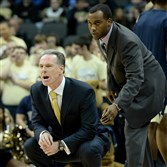 Then-Pitt head coach Jamie Dixon and then-assistant coach Brandin Knight watch as the Panthers face Duquesne on Dec. 4 at Consol Energy Center.
