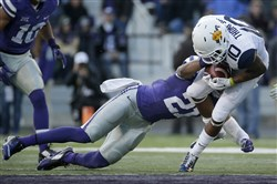West Virginia wide receiver Jordan Thompson is tackled by Kansas State defensive back Kendall Adams during today's game in Manhattan, Kan.