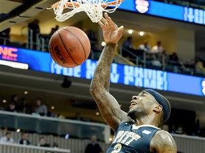 Michael Young dunks in last year's City Game against Duquesne.