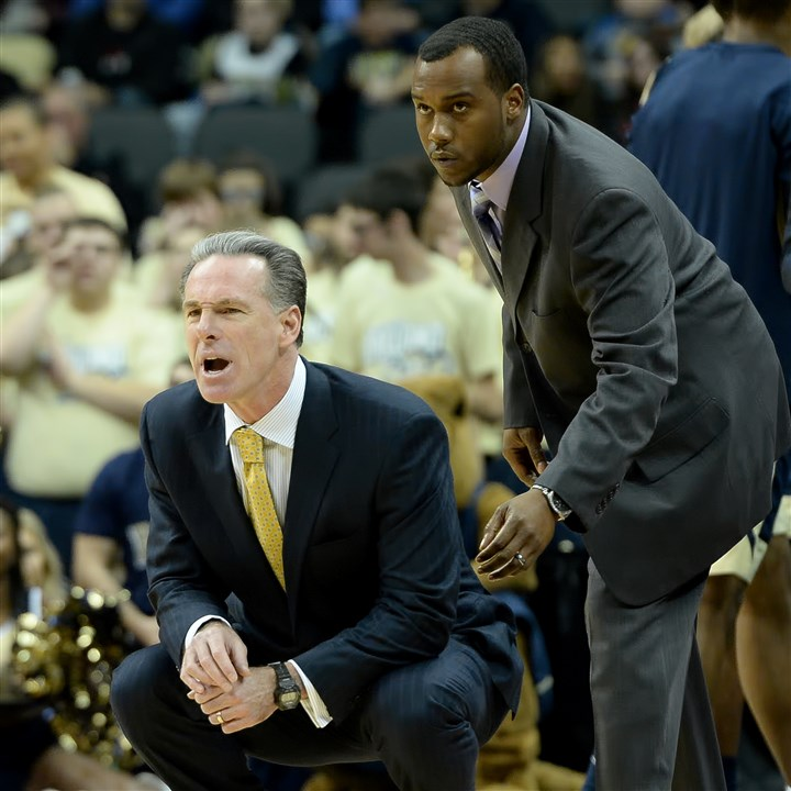 20151204mfpittsports16-8 Then-Pitt head coach Jamie Dixon, left, and assistant coach Brandin Knight watch as the Panthers face Duquesne in December at Consol Energy Center.