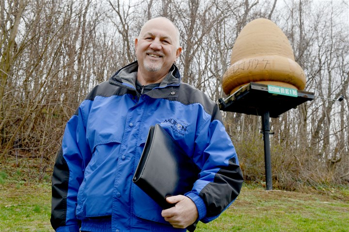 20151203ppUFOSUNLOC John Ventre, state director of the Mutual UFO Network, stands in front of a replica of an unidentified flying object that came down Dec. 9, 1965, in Kecksburg, Pa.