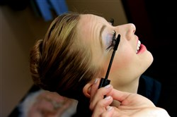 "Julia Erickson applies mascara as she prepares to dance the role of the Snow Queen in the final dress rehearsal of Pittsburgh Ballet Theatre's production of ""The Nutcracker"" at the Benedum Center Downtown."