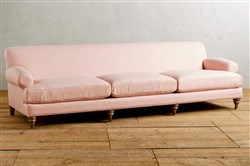 The Linen Willoughby Grand Sofa from Anthropologie in Rose Quartz.