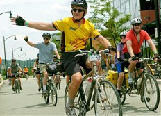 Mike Magnan of Mesa, Az. waves to other bikers as he rolls into the South Side to complete the Greenway Sojourn bike trek on  Saturday, June 30, 2007. Around 500 cyclists spent eight days riding the 335 miles from Washington, DC to Pittsburgh along the nearly completed Great Allegheny Passage.