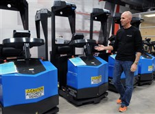 Seegrid Corp. makes vision-guided vehicles with technology developed by Carnegie Mellon University. CEO Jim Rock shows autonomous tugger robots at Seegrid in Coraopolis.