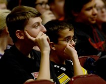 Eighth-graders at Springdale Junior-Senior High School, Levi Baer, 14, and Matthew Sander, 14, listen to a presentation by Socialize Right about online etiquette and managing social media profiles.
