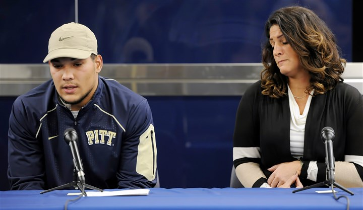 20151204mfconnersports02-1 Pitt running back James Conner sits next his mother, Kelly Patterson, at Friday's news conference on the South Side.