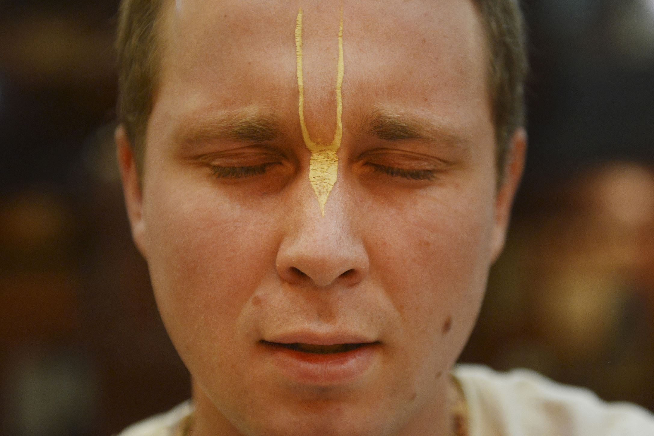 """20151210JR-NewVrindaban8-9 Pranatakaruna dasa, 25, of Wheeling, West Virginia, chants in the temple at New Vrindaban Wednesday, Dec. 9. Mr. Dasa said there is no conflict between Hare Krishna beliefs and """"fracking"""" because the land is Krishna's. """"How can you give up something that doesn't belong to you? Intention plays a large part of it,"""" he said."""