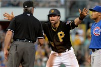 Neil Walker argues with an umpire after being called out during a rundown against the Cubs in August 2015.
