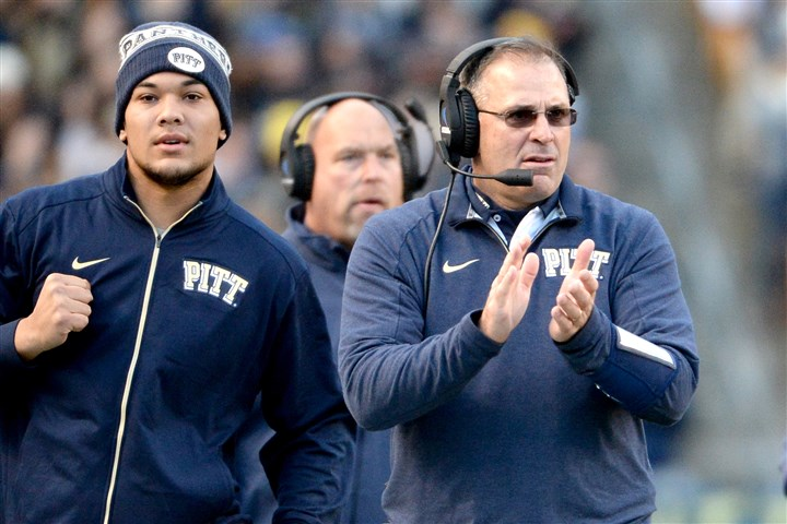 20151121mfpittsports11-2 Pitt coach Pat Narduzzi applauds a touchdown by his team next to James Conner in last season's game against Louisville. Conner participated in an offseason workout this morning.