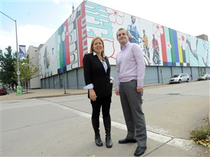 """Sprout Fund founders Cathy Lewis Long and Matt Hannigan with the East Liberty mural """"Lend Me Your Ears,"""" the 2004 piece by Jordan Monahan."""