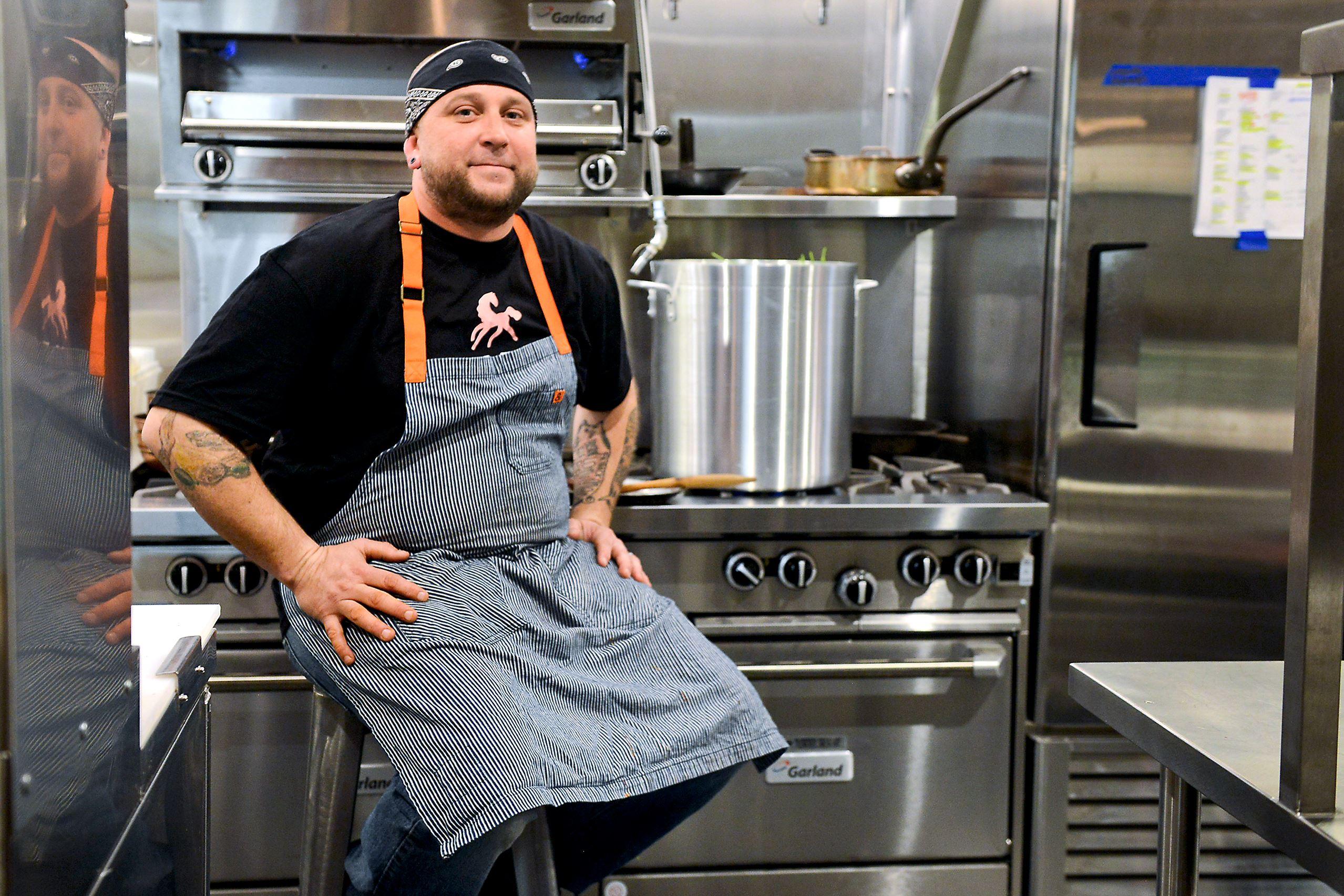 20151213JRTable1 Stephen Eldridge in his kitchen at Smallman Galley Saturday in the Strip District.