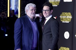 "George Lucas, left, and J.J. Abrams arrive at the world premiere of ""Star Wars: The Force Awakens"" on Dec. 14, 2015, in Los Angeles."
