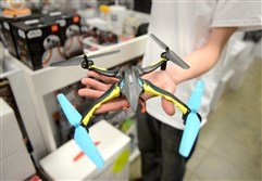 Andy Schettley, an employee at Hobby Express in Cranberry and quadcopter enthusiast, shows a quadcopter.