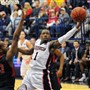 Robert Morris Andre Frederick, left, guards Duquesne Derrick Colter, right, under the net in a 72-65 Dukes win earlier this month.