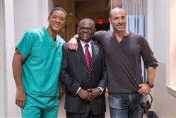 "From left, Will Smith, the real Dr. Bennet Omalu, and director Peter Landesman on the set of  ""Concussion."""