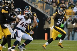 The Steelers' DeAngelo Williams pulls in a pass Dec. 20 against the Broncos at Heinz Field.