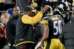 Steelers head coach Mike Tomlin congratulates Ryan Shazier after intercepting a ball against the Broncos in the regular season at Heinz Field.