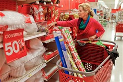 Holly Bryan stocks up on Christmas wrapping paper and other holiday items while shopping for day after Christmas deals at a Target store in Chattanooga, Tenn., in 2012.