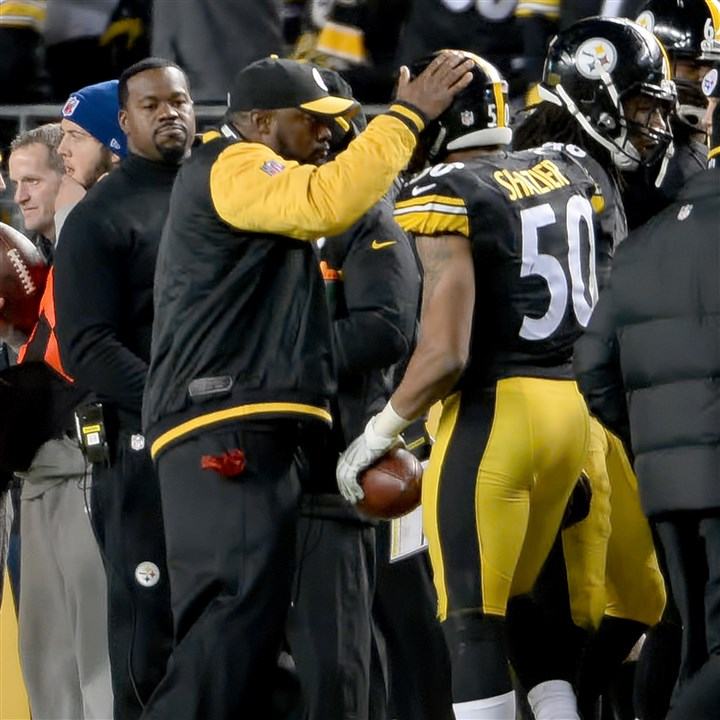 20151220mfsteelerssports16-2 Steelers head coach Mike Tomlin congratulates Ryan Shazier after intercepting a ball against the Broncos in the regular season at Heinz Field.