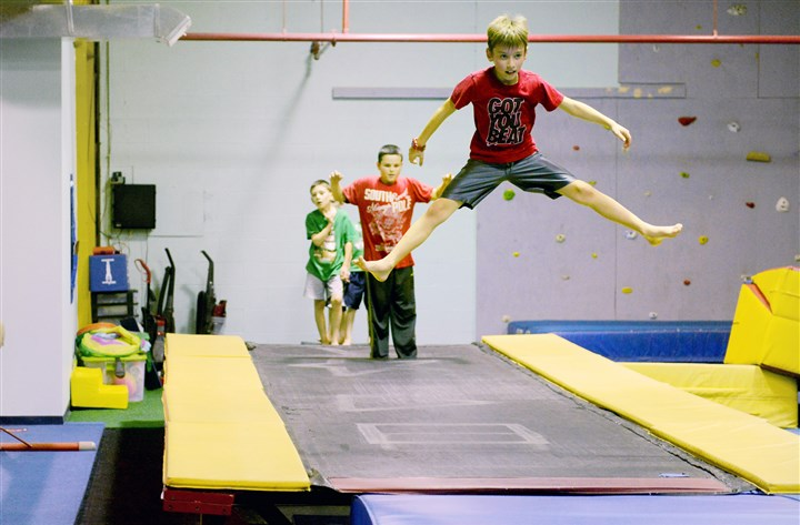 20151214MWHninjaLocal03-2 With a line of boys waiting their turn behind him, Andrew Donaldson, 8, jumps on a trampoline last month during a Ninja class at True Gymnastics in Castle Shannon.