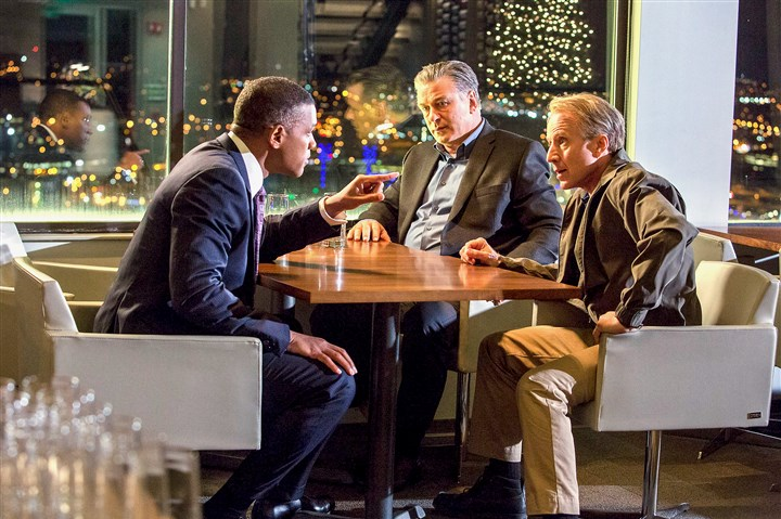"20151224hdConcussion01Mag In a scene from the film ""Concussion,"" Dr. Bennet Omalu, played by Will Smith, left, meets with, Dr. Julian Bailes, played by Alec Baldwin, and Dr. Joseph Maroon, played by Arliss Howard. Dr. Omalu urges Dr. Maroon to tell the truth about injuries to NFL players."