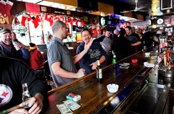 Jason Chandler, left, and Paul Fedak share a laugh and a beer Christmas morning at Jack's on the South Side.