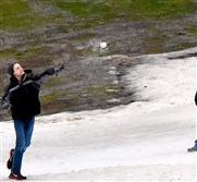 Jason Carpenter, left, 14, and his mother, Larissa, of Bradenton, Fla., had just enough snow to throw snowballs and roll around at the Boyce Park Ski Slopes Saturday afternoon. It was the first time Jason had seen snow. The slopes closed early after high temperatures made it impossible to make snow.