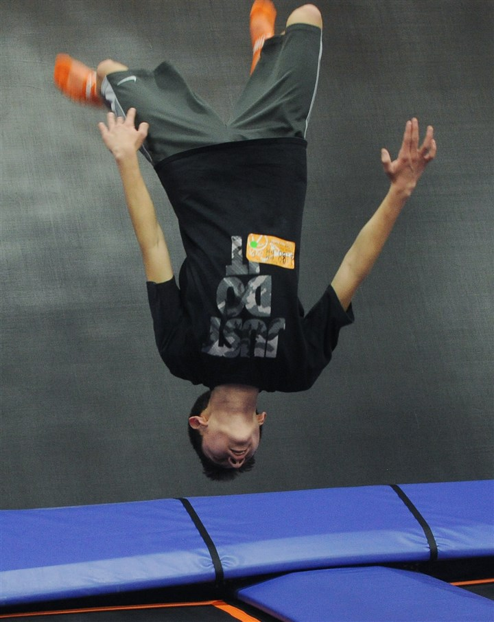 20151226ng-Trampoline3-1 Justin Maines, 13, of Clearfield County, does a flip on the trampoline at Sky Zone in Monroeville.