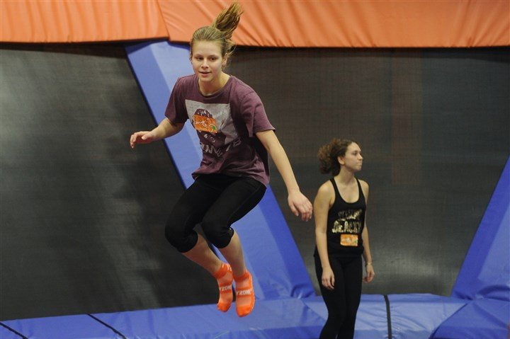 20151226ng-Trampoline8 Amelia Young, 18, of Boston, MA., jumps on the trampoline at Sky Zone in Monroeville.