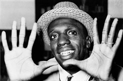 Meadowlark Lemon shows off his large hands on arrival in London in 1959 where the team was to perform at the Empire Pool in Wembley.
