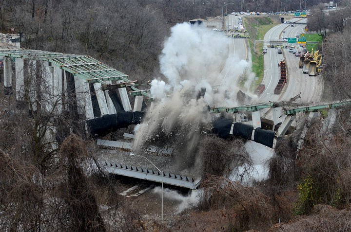 20151228radGreenfieldBridgeDemolition The Greenfield Bridge falls onto the Parkway East Monday morning.