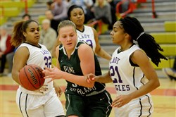 Pine Richland's Amanda Kalin dribbles as Obama's Trese Williams, right, defends on Dec. 28.