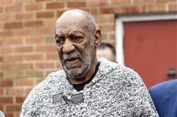 Comedian Bill Cosby leaves December 30, 2015 the Court House in Elkins Park, Pennsylvania after arraignment on charges of aggravated indecent assault.