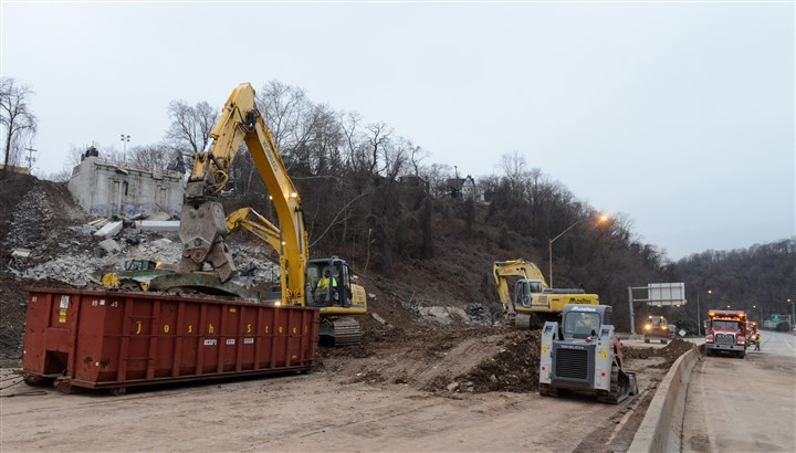 20151230rldGreenfieldBridge03-2 Crews from Mosites Construction work to clear Interstate 376's westbound and eastbound lanes of the remains of the Greenfield Bridge which had been imploded.