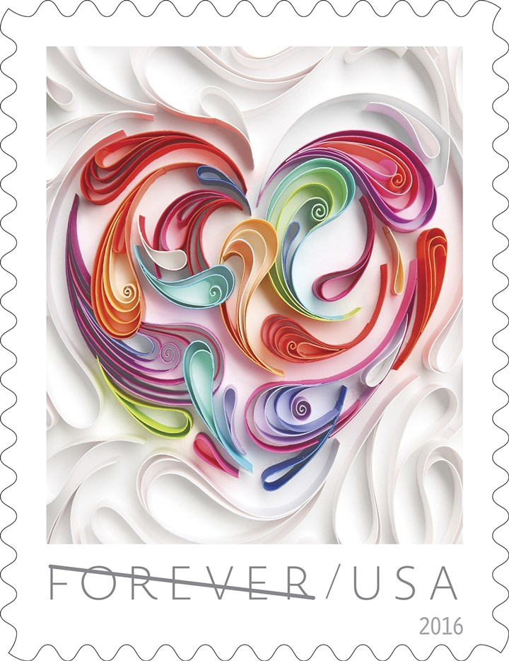 Stamps1231260 This stamps showcases a quilled paper heart, which has folded pieced of colored paper surrounded by folded pieces of white paper to form a heart.