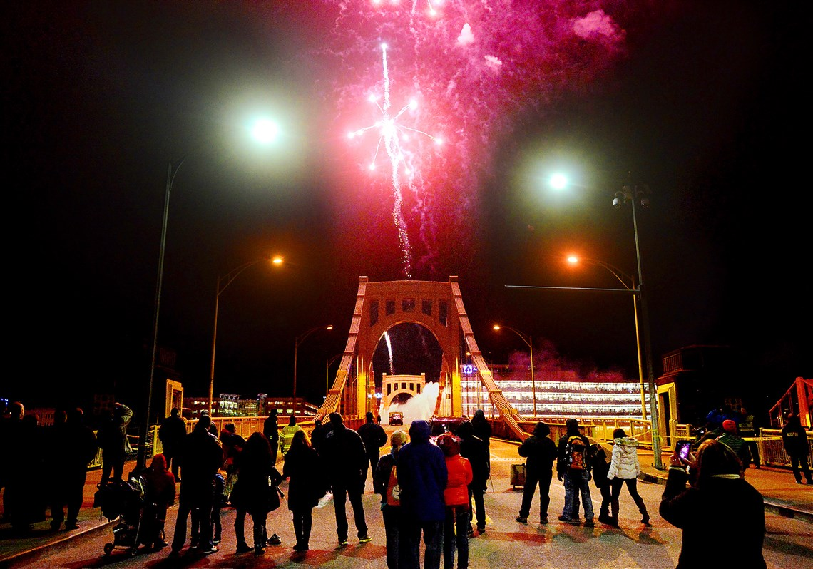 Spectators Gather For The First Set Of Fireworks On The 7th Street Bridge  During First Night