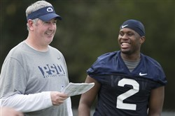 Former tight end Brent Wilkerson shares a light-hearted moment with New offensive coordinator Joe Moorhead during a Dec. 31 practice.