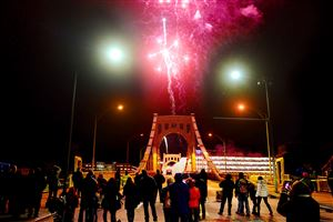 Spectators gather for the first set of fireworks on the Andy Warhol Bridge during First Night Pittsburgh, the annual New Year's Eve celebration, in Downtown Pittsburgh on Thursday, Dec. 31, 2015.