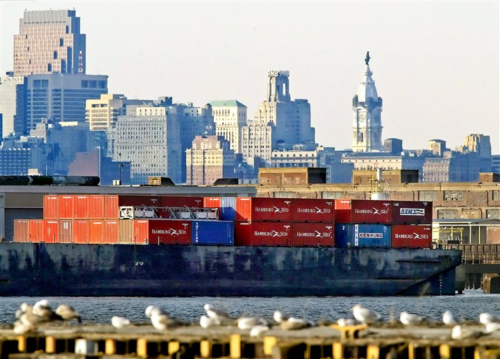 20150102apShipping Shipping containers rest on a barge in the Delaware River as the city of Philadelphia is seen in the background.