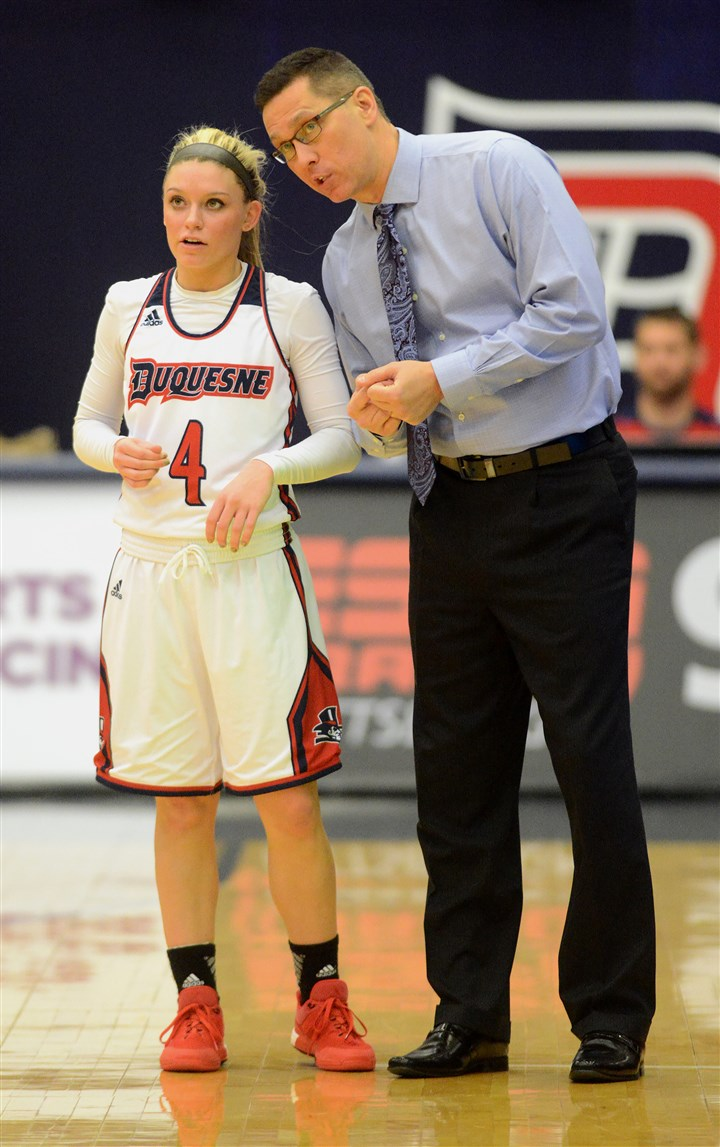 20160103radDuquesneSpts08-7 Duquesne University women's basketball coach Dan Burt talks with guard Chassidy Omogrosse during a time out in their 89-58 win over Dayton.