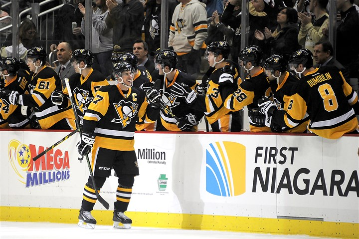 20160102rldPensVsIslanders04-2 Sidney Crosby celebrates after scoring his second goal of the night in the second period Saturday night against the New York Islanders at Consol Energy Center. The Penguins won, 5-2.