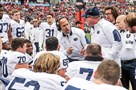 Penn State head coach James Franklin, center, talks with players along the bench during the first half of the TaxSlayer Bowl on Jan. 2 in Jacksonville, Fla.