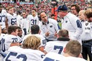 Penn State coach James Franklin, center, talks with players along the bench during the first half of the TaxSlayer Bowl against Georgia.