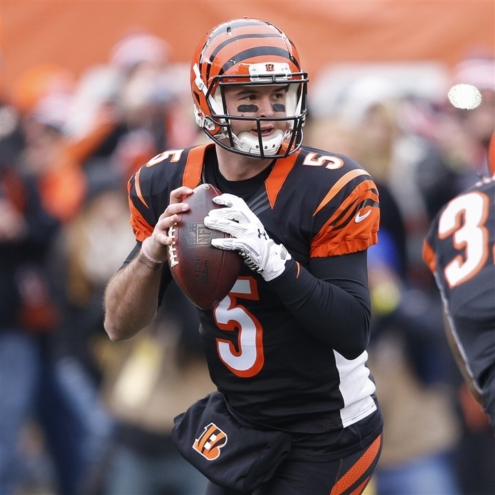 Ravens Bengals Football Bengals quarterback AJ McCarron looks to pass in the first half against the Baltimore Ravens, Sunday, Jan. 3, 2016, in Cincinnati.