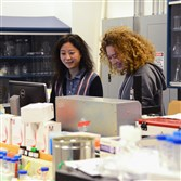 In this 2016 photo, Qi Yan, left, a scientific director and Emma Hartman, a scientist at Sharp Edge Labs, worked at the lab on the South Side. Sharp Edge is expected to move into Pitt's new life sciences business accelerator.