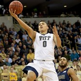 Pitt's James Robinson, who runs the show for an offensive-minded Panthers team, drives to the net against Georgia Tech's Adam Smith in the first half Wednesday night at Petersen Events Center.