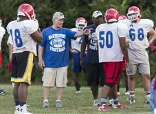 George Smith talks to his players during a McKeesport High School football practice in August, 2015.