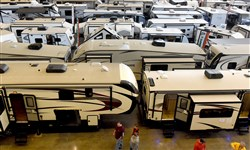 Appearing like the infield of a NASCAR race, visitors browse the hundreds of recreational vehicles on display on two floors at the Pittsburgh RV show held at the David L. Lawrence Convention Center last year.