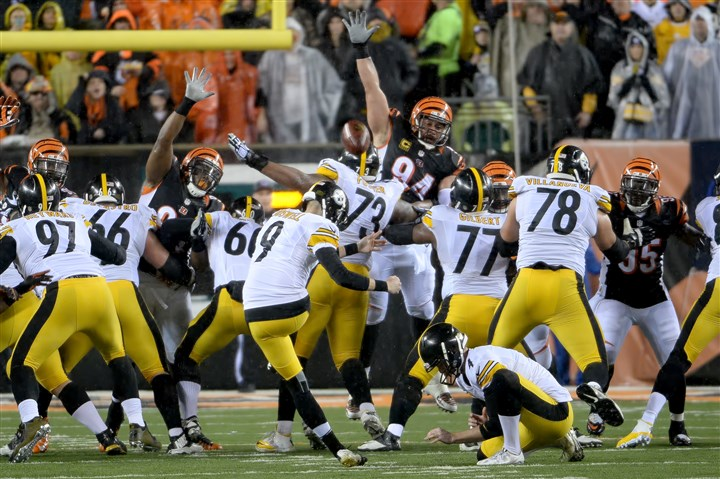 20160109mfsteelerssports09-1 Steelers' Chris Boswell kicks a field goal against the Bengals in the second quarter of the AFC Wild Card game Saturday at Paul Brown Stadium.